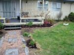 Working on the Front Garden with edging and weeding being slowly done. Garden Mix is being added to supplement the tired existing soil. Our Boysenberry Plant is also located there too - DOUBLE YUM