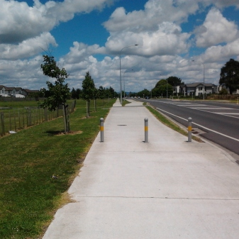Bollards protecting the shared path as it goes into dedicated cycle and foot paths