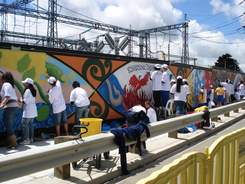 Painting the mural wall outside the Otahuhu  Transpower switch yard Source: Auckland Council