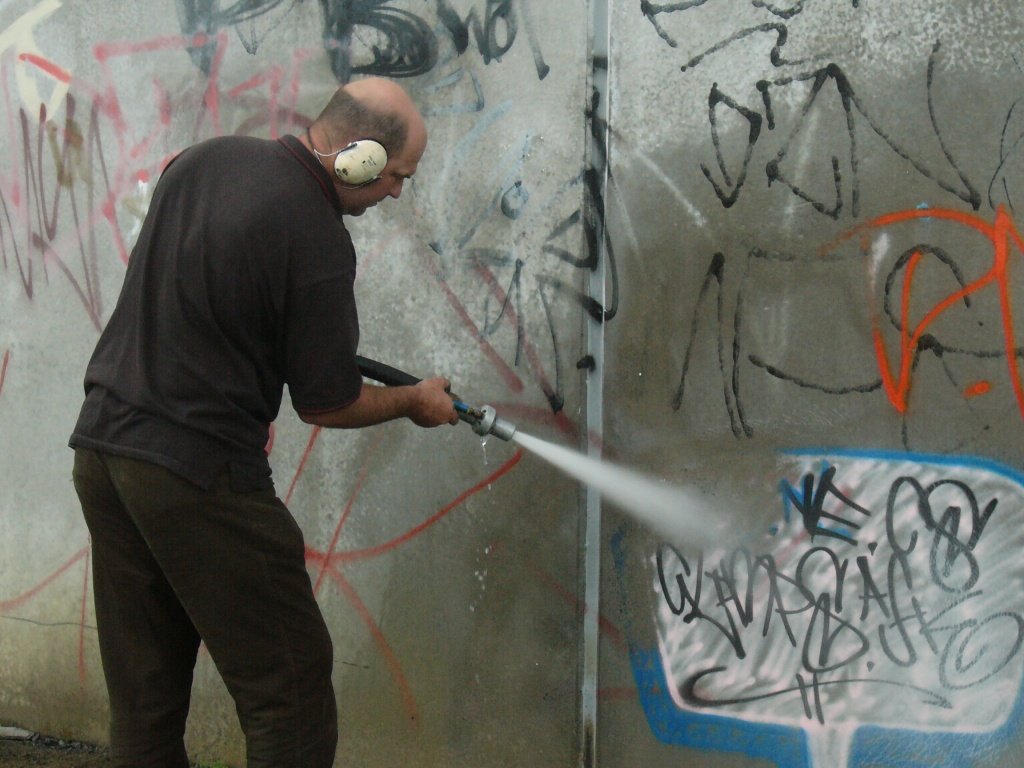 Washing off graffiti  Source: Auckland Council