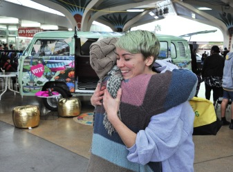 Lucy-Mary Mulholland was working on the voter engagement stand and got a lovely hug from an affectionate Auckland voter Source: Auckland Council