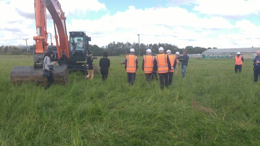 The party consisting of Dr Nick Smith, Phil Goff, Bill Cashmore and Auranga MD Charles Ma making their way to the digger