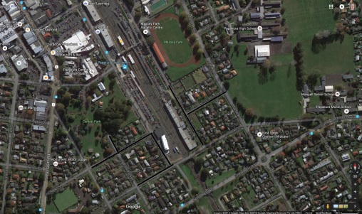 Papakura Park and Ride overflows Black lines are where cars have parked and their drivers walking to catch the trains north