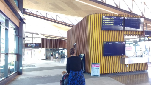 Inside Manukau Bus Station looking at a ticket office